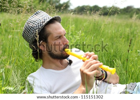 A man playing his flute outside