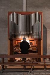 A man plays the organ in a church