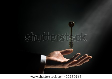 a man pointing to the gold key