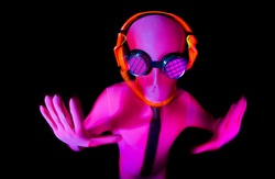 a man poses inside a pink UV glow suit