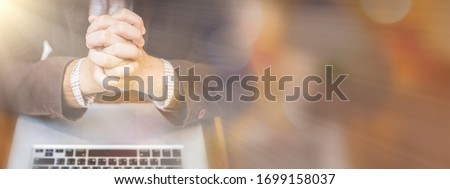 A man praying by faith with computer laptop ,Church services online concept, Online church at home concept, spirituality and religion.