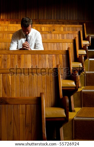 A man praying in church