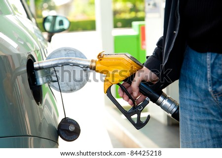 A man pumping diesel in to the tank