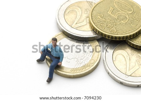 a man (puppet) sitting on some Euro coins