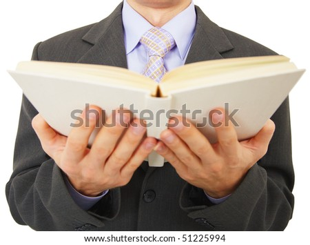 A man reads a big book, isolated on a white background