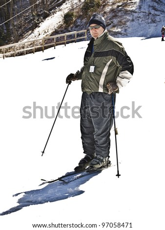 A man ready to hit the slopes for some fun.