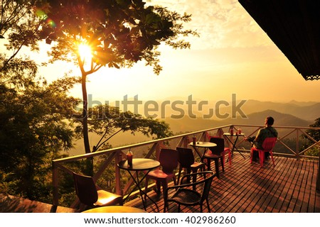 A Man Relax at The Cafe on The Hill