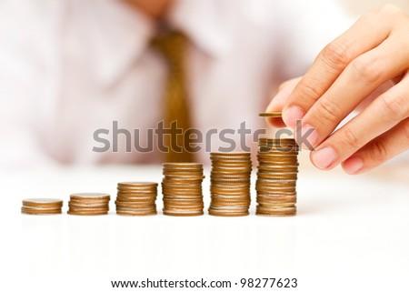 a man rising coins - stock photo