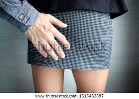 A man's hand catches a woman's an ass and leg of office girl. He is sexually abusing. Woman office wear short skirt be assaulted sexually. Mental Health and Sexual Abuse Concept. #1515432887