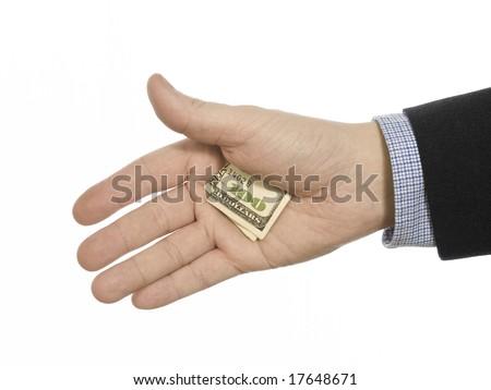 A man's hand hiding a hundred dollars tip.