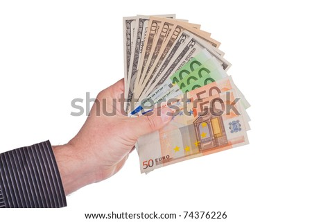 A man's hand holding a handful of euro and dollars.