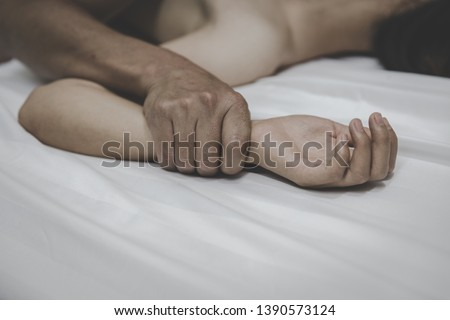 A man's hand holding a woman hand for rape and sexual abuse concept,  Detain rape, sexual abuse , human trafficking, domestic violence rape.