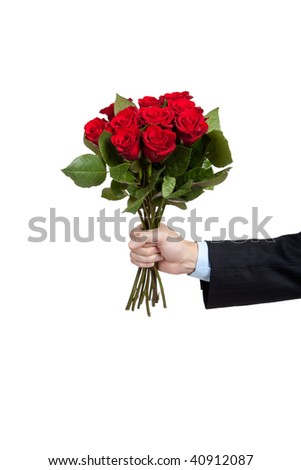 man's hand holdng a dozen red roses on a white background with copy ...