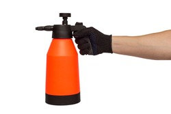 A man's hand holds hand-pumped sprayer isolated on white background. Garden pressure sprayer for dispensing fertilizer, pesticide or herbicide. Garden accesories.