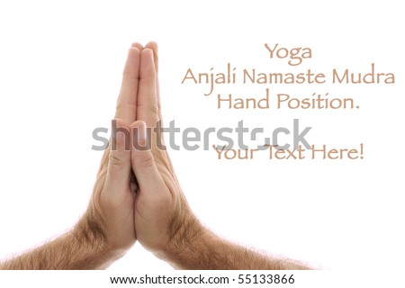 A man's hand is shown in yoga Anjali mudra and is  used as a salutation or greeting hands are held over head or heart.  Shot over white.