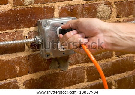 how to add a electrical outlet in brick wall