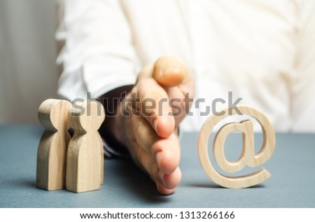 A man's hand separates people from the Internet. The concept of blocking access to the World Wide Web, self-isolation and traffic filtering. the great firewall. Control over the Internet. Stock photo ©