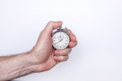 a man's hand with a stopwatch on a white background in the right part of the text space