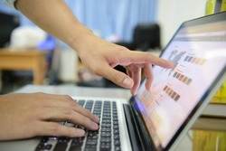 a man's hands using a laptop at home, rear view of business man hands busy using laptop at office desk