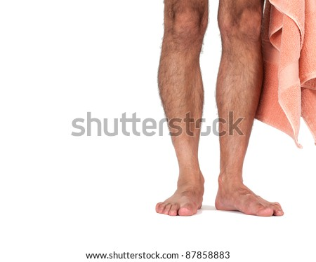 A man's naked legs standing with towel