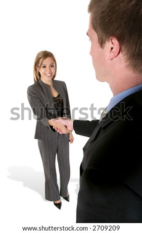 A man shaking a pretty woman's hand in a business setting - stock photo