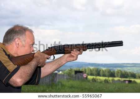 A man shoots a gun on skeet