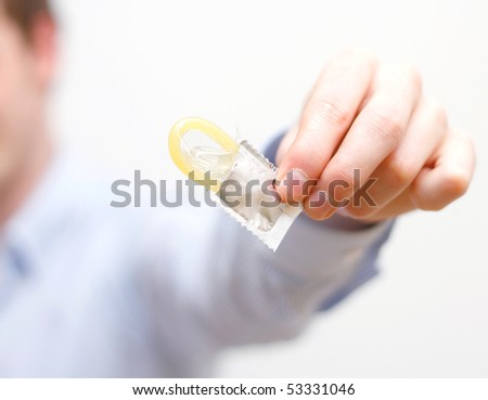A man showing a condom