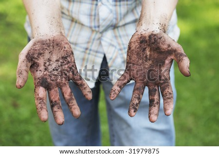 A Man showing dirty hands after gardening work - stock photo