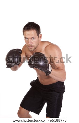 A man showing his great style and movement while practicing his boxing moves with his boxing gloves on .