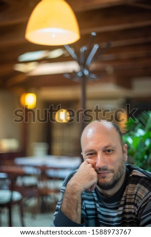 A man sits alone in a restaurant