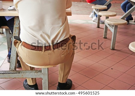 a man sitting on a cafe chair....
