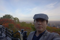 a man standing at mount royal lookout in parc du mont royal in montreal of quebec, canada in the morning