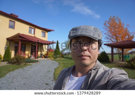 a man standing in front of entrance of massage shop on the summit drive of eastern townships in quebec, canada