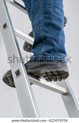 A man standing on a ladder #612455936