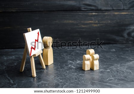 A man stands near the rack with a poster and a red arrow up. The teacher teaches the child. Education. Growth of indicators and productivity, achievement of new peaks. Economy lessons.