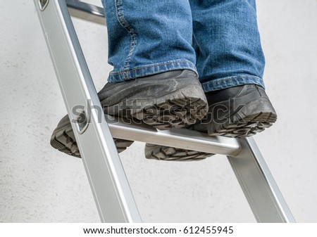 A man stands on a ladder #612455945