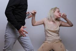 a man takes a bottle of a woman. female alcoholism