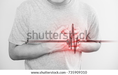 a man touching his heart, with heart pulse sign, concept of heart attack, and others heart disease Stock photo ©