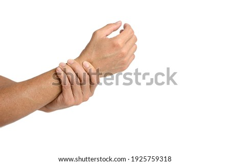 A man touching his injured wrist on white background. Сток-фото ©