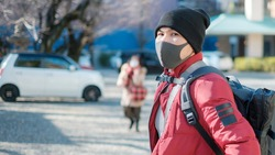 A man travel in japan with new normal concept,Man with face mask travel in Japan