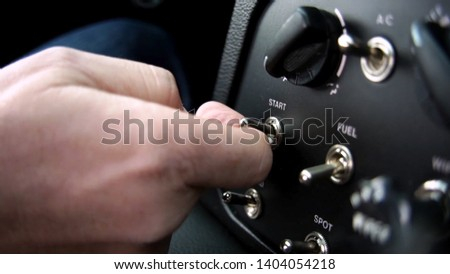 A man turns on the ignition to a sports car #1404054218