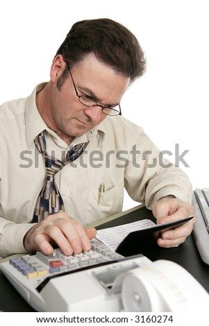 A man using a calculator to balance his checkbook.  Isolated on white.