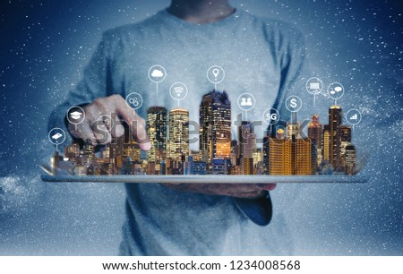 a man using digital tablet with building hologram and internet media icons. Smart city, 5g, internet and networking technology concept