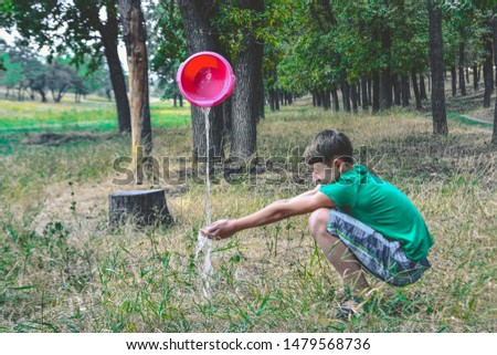 A man washes his hands from an unknown source, water flows from the top. Magical miracles in a magical forest. #1479568736