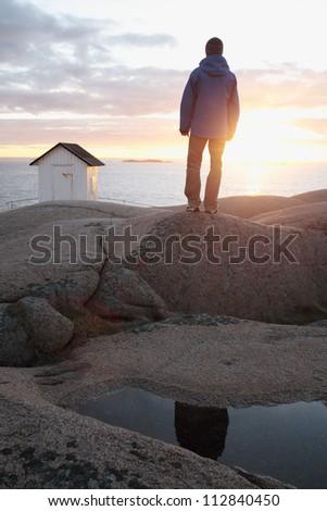A man watching the sun go down, Bohuslan, Sweden.