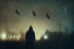 A man watching three witches on broomsticks flying across the sky in a city on a spooky winters night. With a grunge, abstract edit.