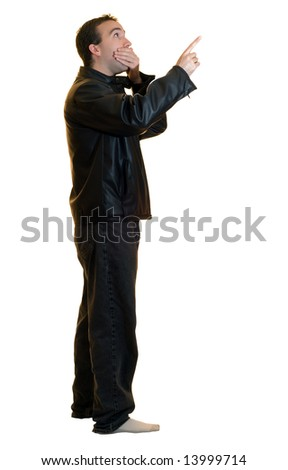 A man wearing a black leather jacket pointing at something, looking stunned