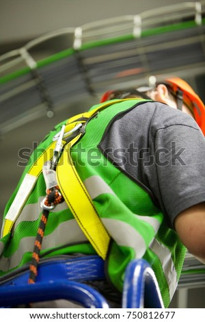 a man wearing high visibility...