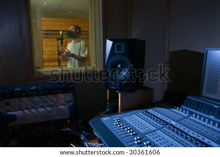 a man who is singing in the music studio - stock photo