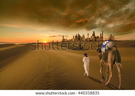 A man with a camel walking in the middle of the desert towards the kuwait city  #440358835